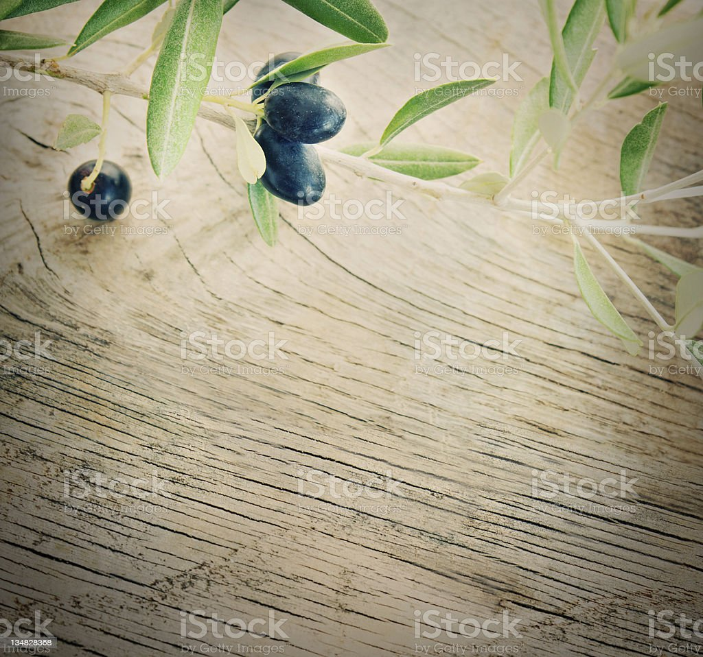 Olive branch on  wood background stock photo