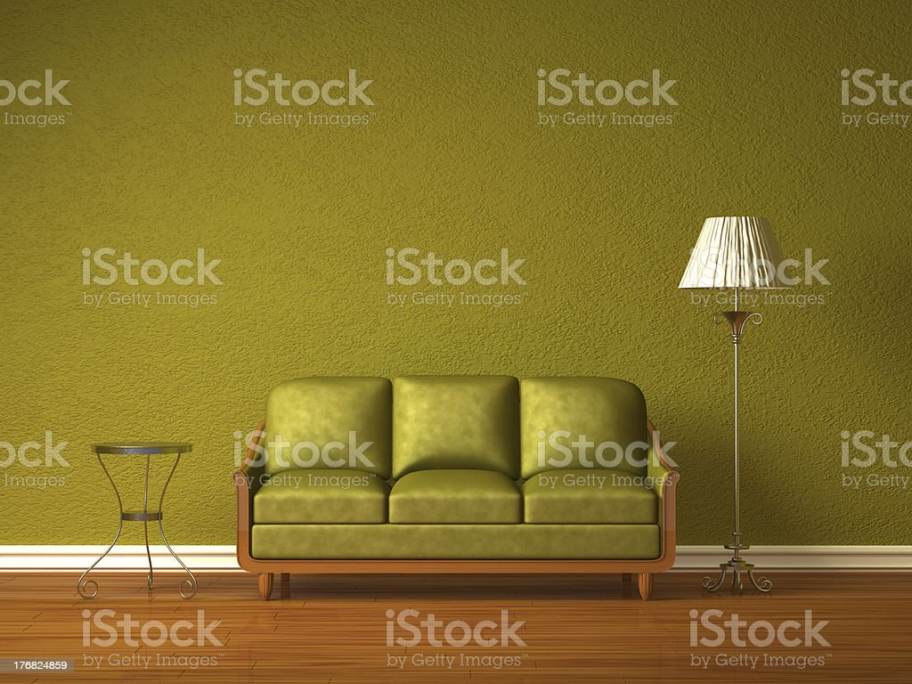 Olive couch with table and standard lamp royalty-free stock photo
