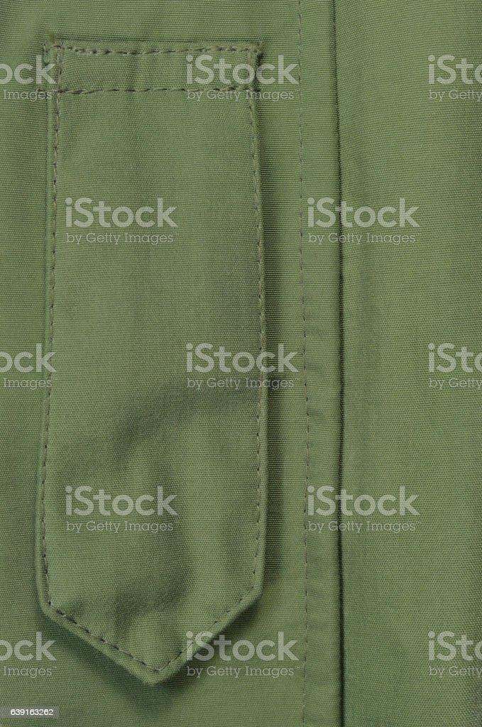 Olive Drab Green ECWCS Parka Rank Insignia Badge Loop Closeup stock photo