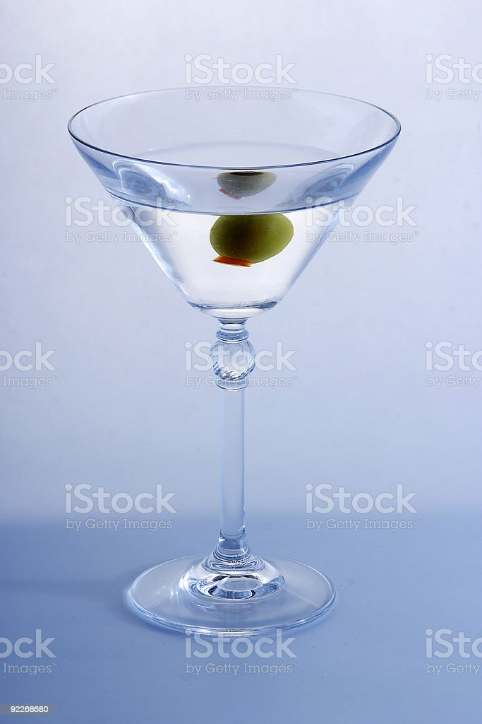 Olive in a martini royalty-free stock photo