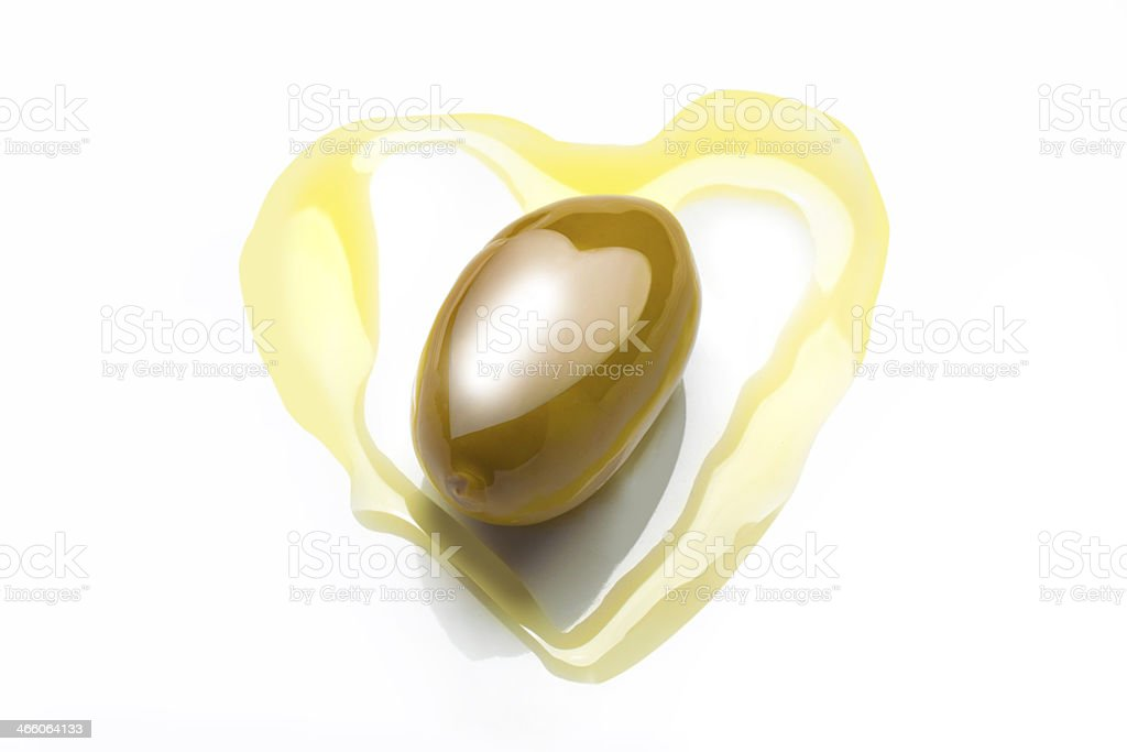 olive in heart shaped  oil stock photo