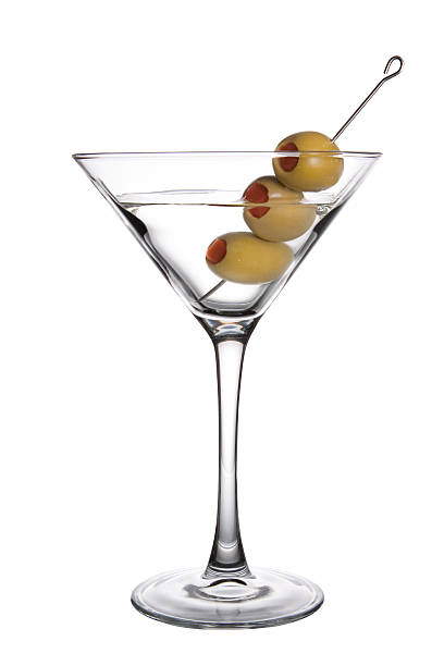 Olive Martini Three Olive Martini on white Background. martini glass stock pictures, royalty-free photos & images