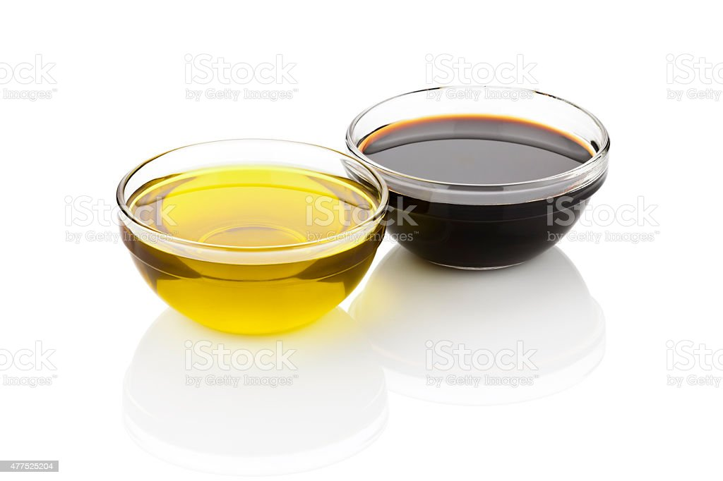 Olive oil and balsamic vinegar in glass bowls stock photo