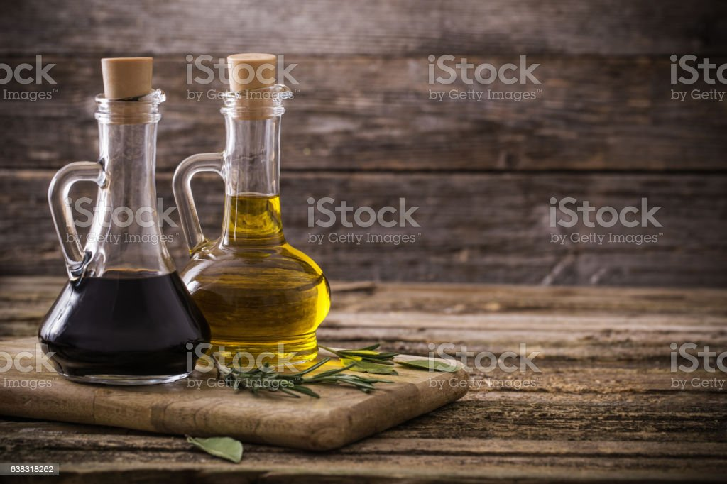 olive oil and balsamic vinegar on a wooden background stock photo