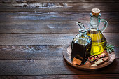 Bottle of olive oil and red wine vinegar for use as a salad dressing