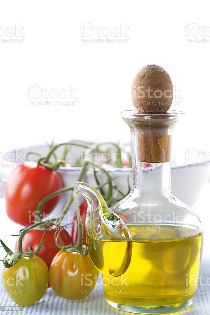 olive oil and branch of organic tomatoes royalty-free stock photo