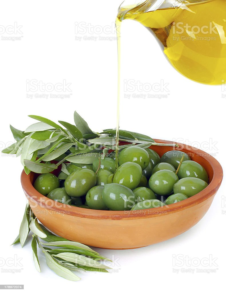 Olive oil and branches royalty-free stock photo