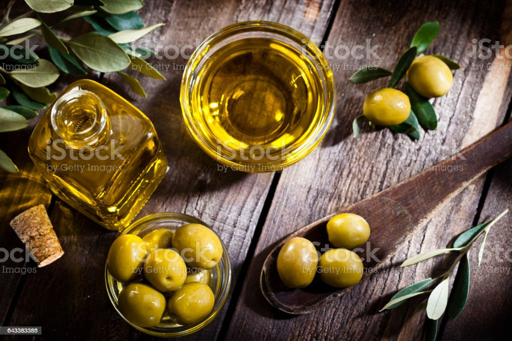 Olive oil and green olives shot from above stock photo