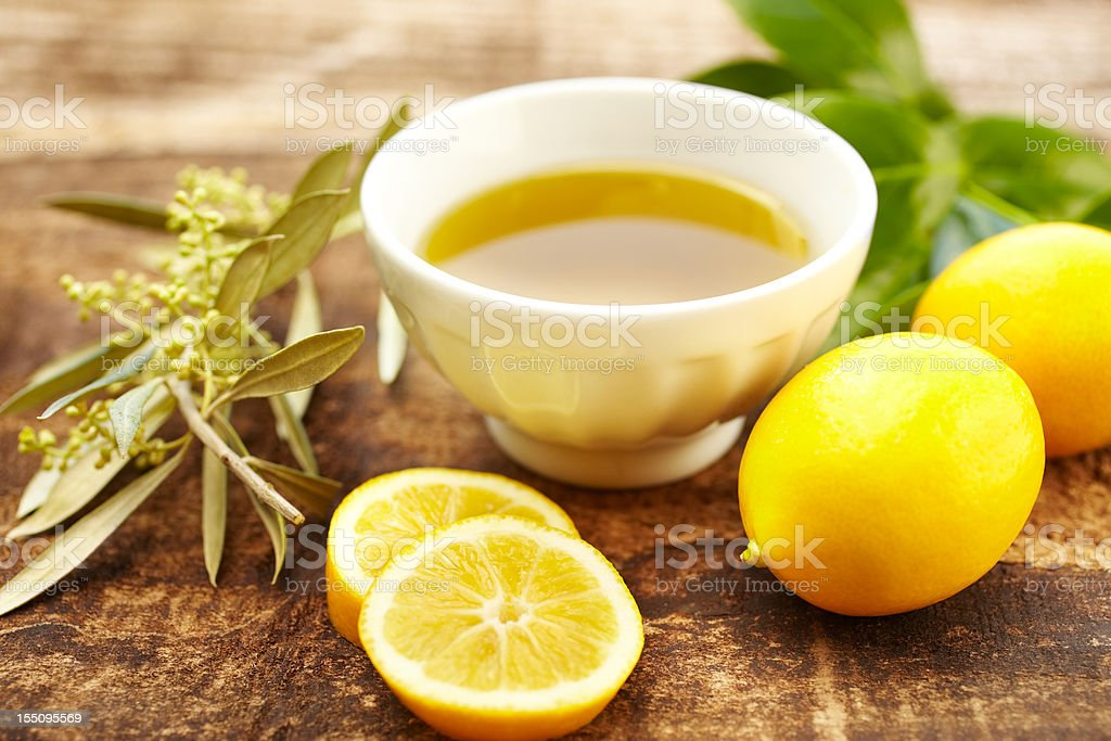Olive oil and lemon spa treatment at a luxury resort stock photo