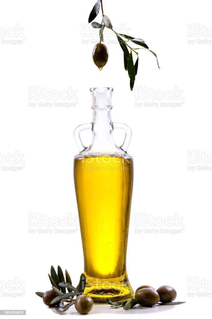 Olive oil and olive branch isolated on white royalty-free stock photo