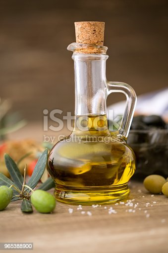 Olive Oil And Olive Branch On The Wooden Table Stock Photo & More Pictures of Agriculture