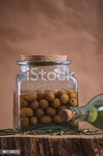 Olive oil and olives in conserve