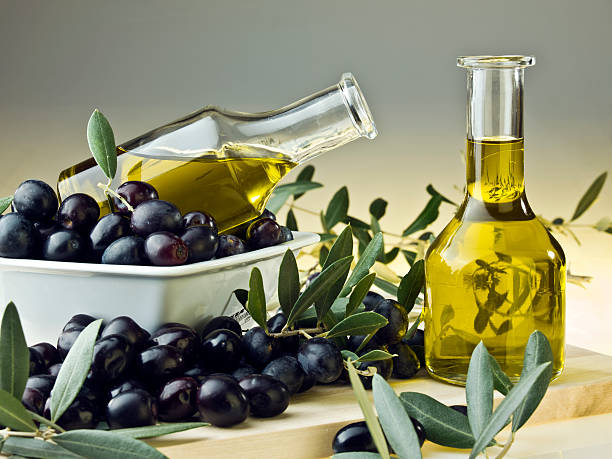 Olive oil and olives stock photo
