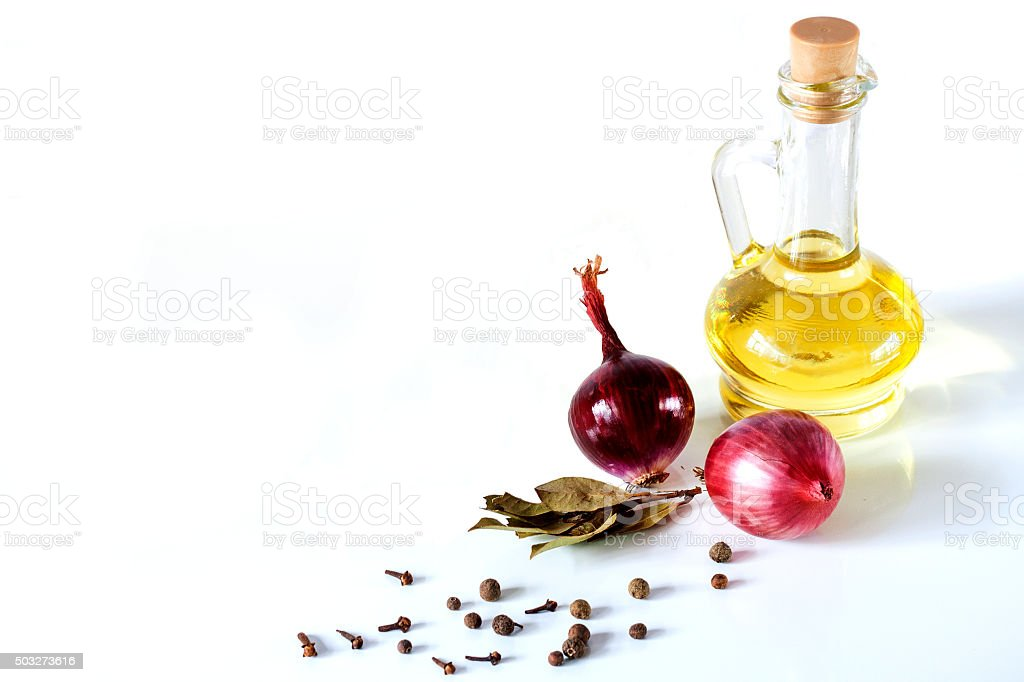 Olive oil and red onion on a white background stock photo