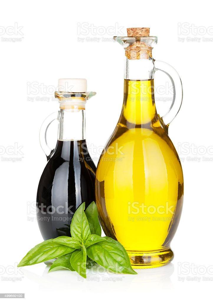 Olive oil and vinegar bottles with basil stock photo