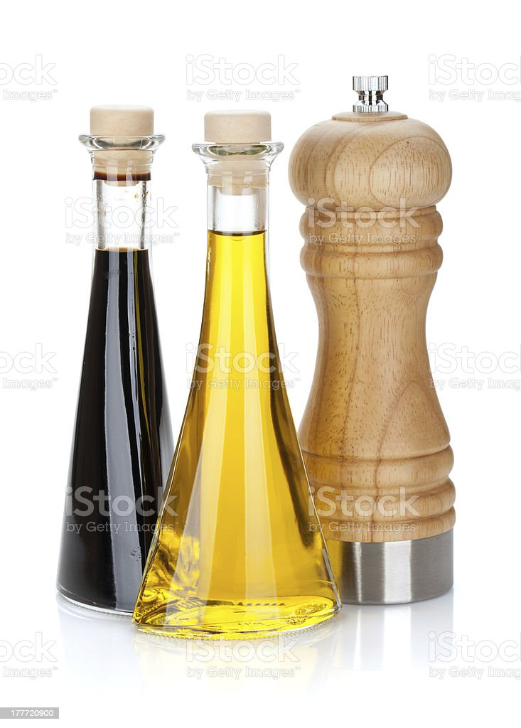 Olive oil and vinegar bottles with pepper shaker royalty-free stock photo