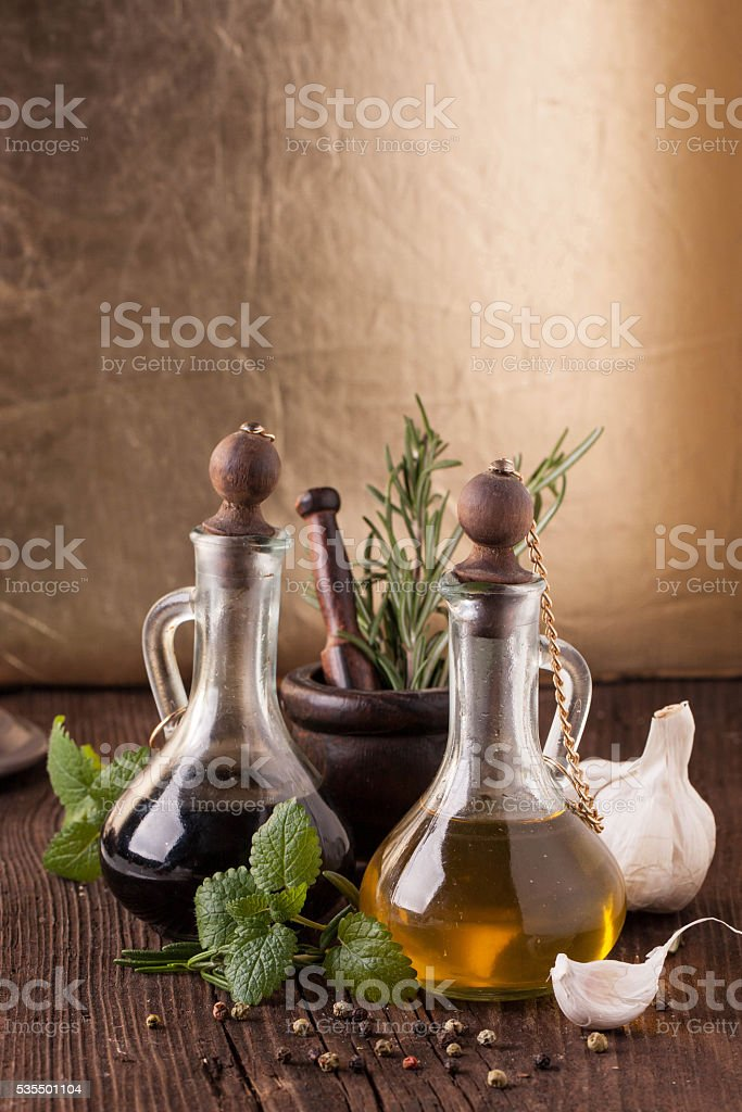 olive oil and vinegar with herbs stock photo
