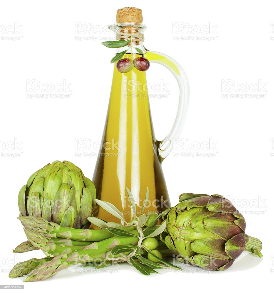 Olive oil, artichokes and  asparagus. royalty-free stock photo