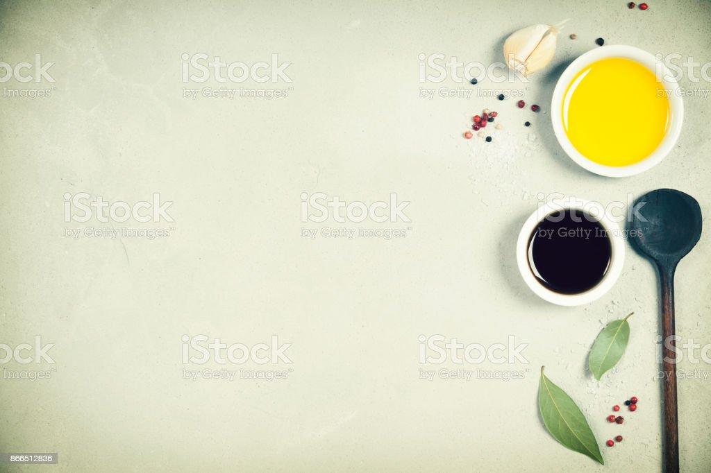Olive oil, balsamic vinegar, pepper and herbs stock photo
