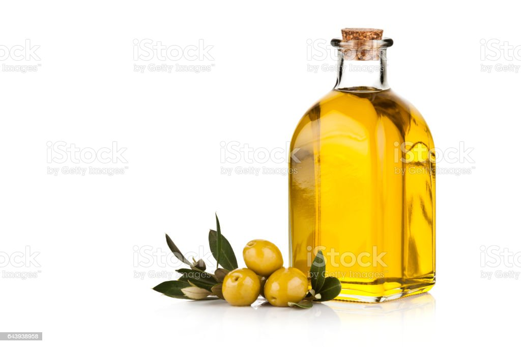 Olive oil bottle and green olives isolated on white background stock photo