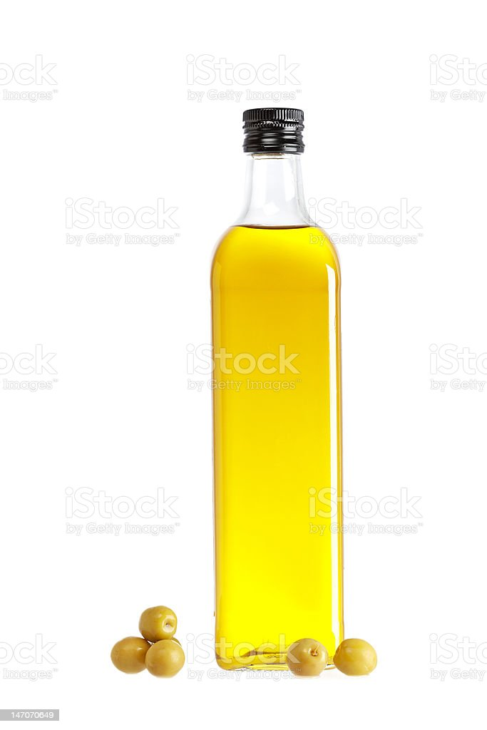 Olive oil bottle and some olives stock photo