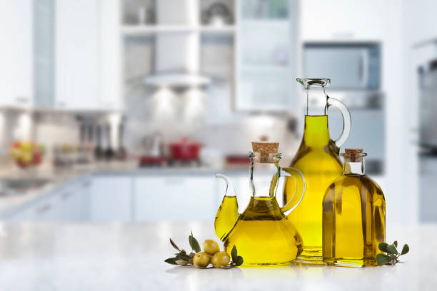 Olive oil bottles on kitchen counter top stock photo