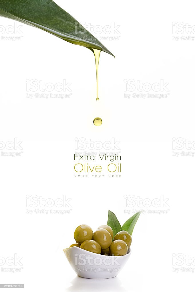 olive oil dripping from a fresh green leaf. Olive seeds stock photo
