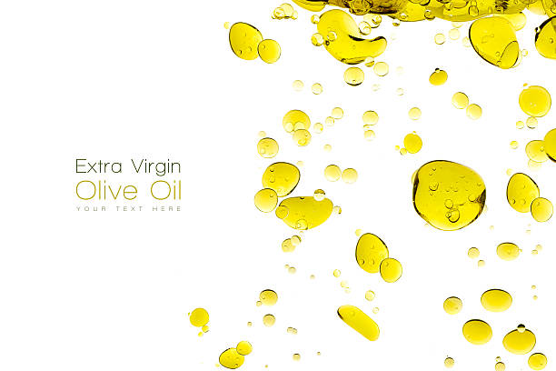 Olive Oil Drops Isolated on White stock photo