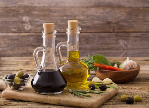 olive oil flavored with spices and other ingredients olive oil flavored with spices and other ingredients balsamic vinegar stock pictures, royalty-free photos & images