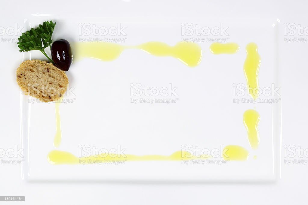 Olive Oil Frame on White Plate royalty-free stock photo