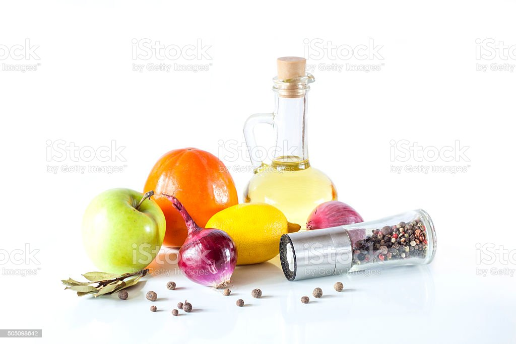 Olive oil, fruits, vegetables and spices on a white background royalty-free stock photo