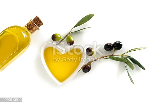 Olive oil heart shape bowl as heart healthy food on white background