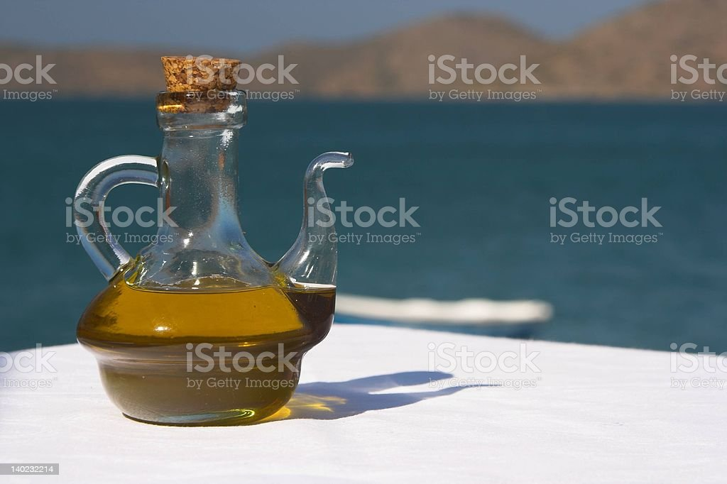 Olive oil in a an outdoor restaurant royalty-free stock photo