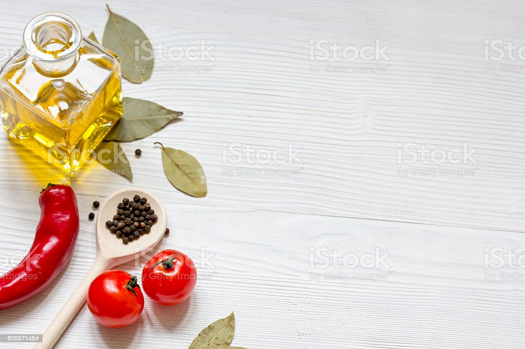 olive oil in jar on wooden background with spices zbiór zdjęć royalty-free