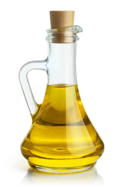 Olive oil on white Delicious olive oil in a glass bottle, isolated on white background olive oil stock pictures, royalty-free photos & images