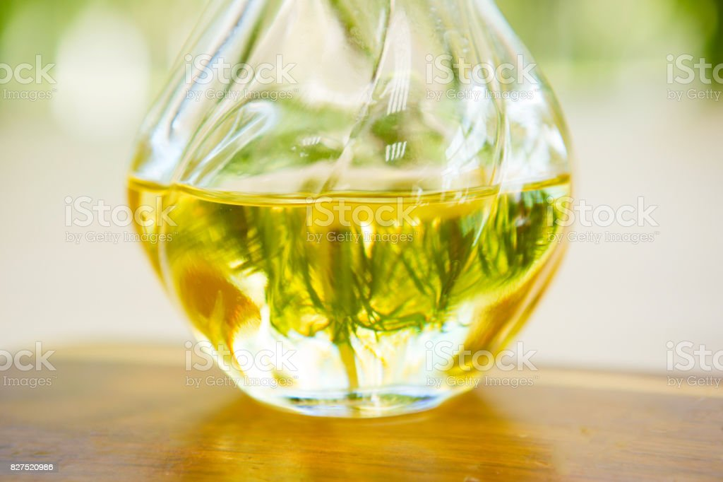 Olive oil on wooden surface. Sunny day stock photo