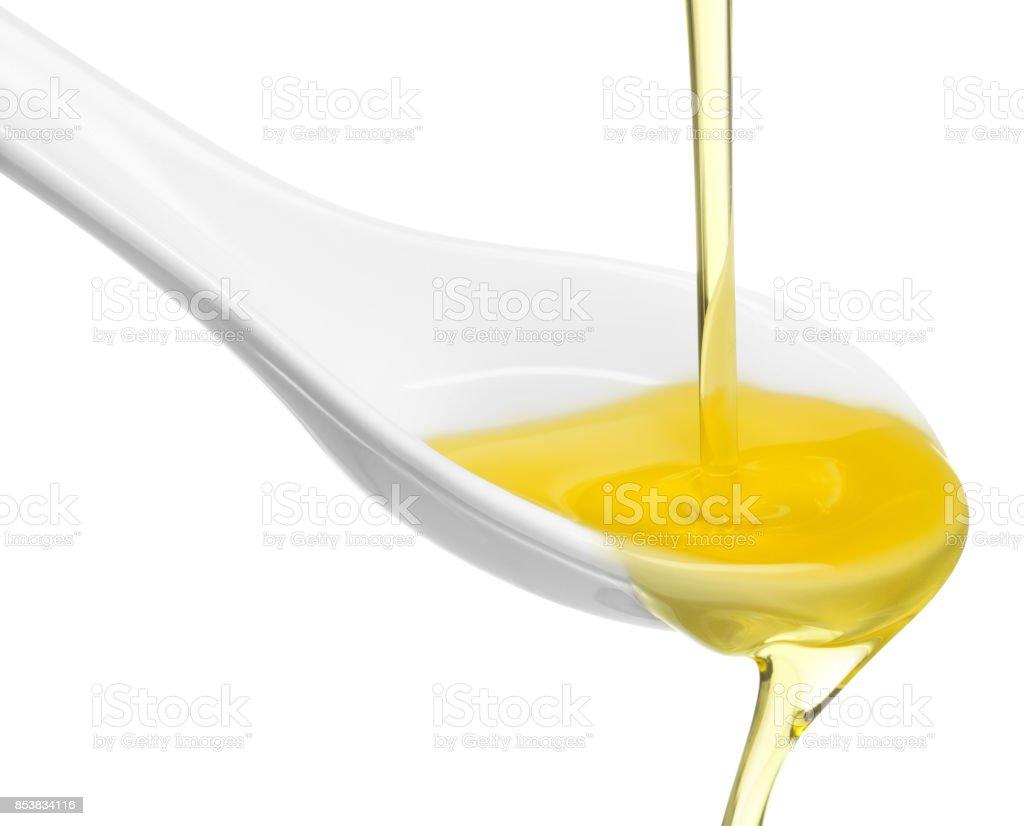 transbordando de uma colher de azeite de oliva - foto de acervo