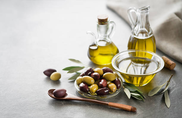 Olive oil Bottle of Extra virgin healthy Olive oil with fresh olives close up olive oil stock pictures, royalty-free photos & images