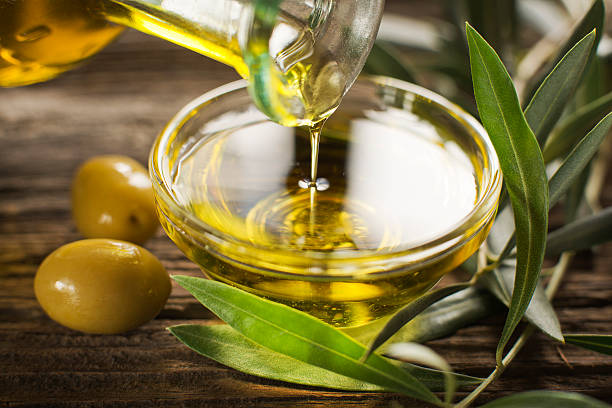 olive oil - olive oil stock photos and pictures