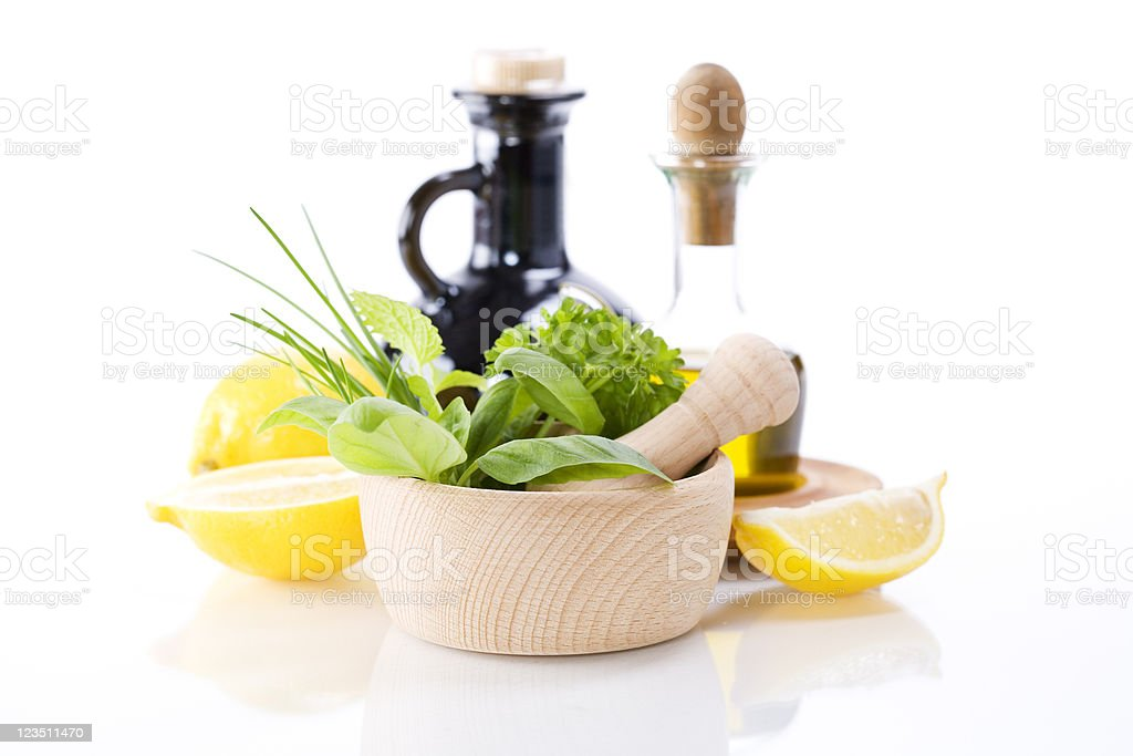 Olive oil, vinegar, Healing herbs and lemon royalty-free stock photo