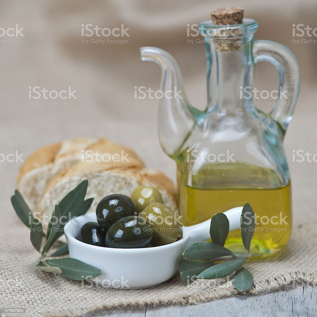 Olive oil with olives and bread royalty-free stock photo
