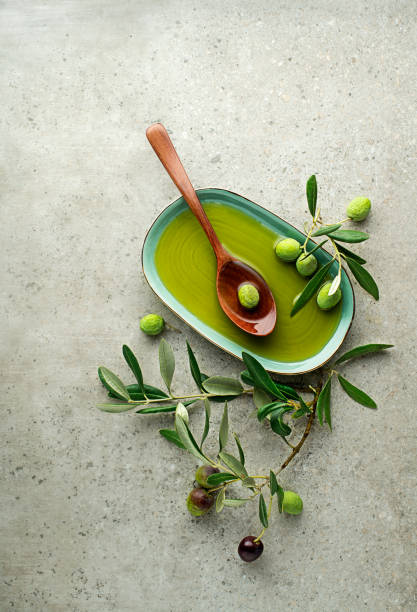 Olive oil with olives and leaves stock photo