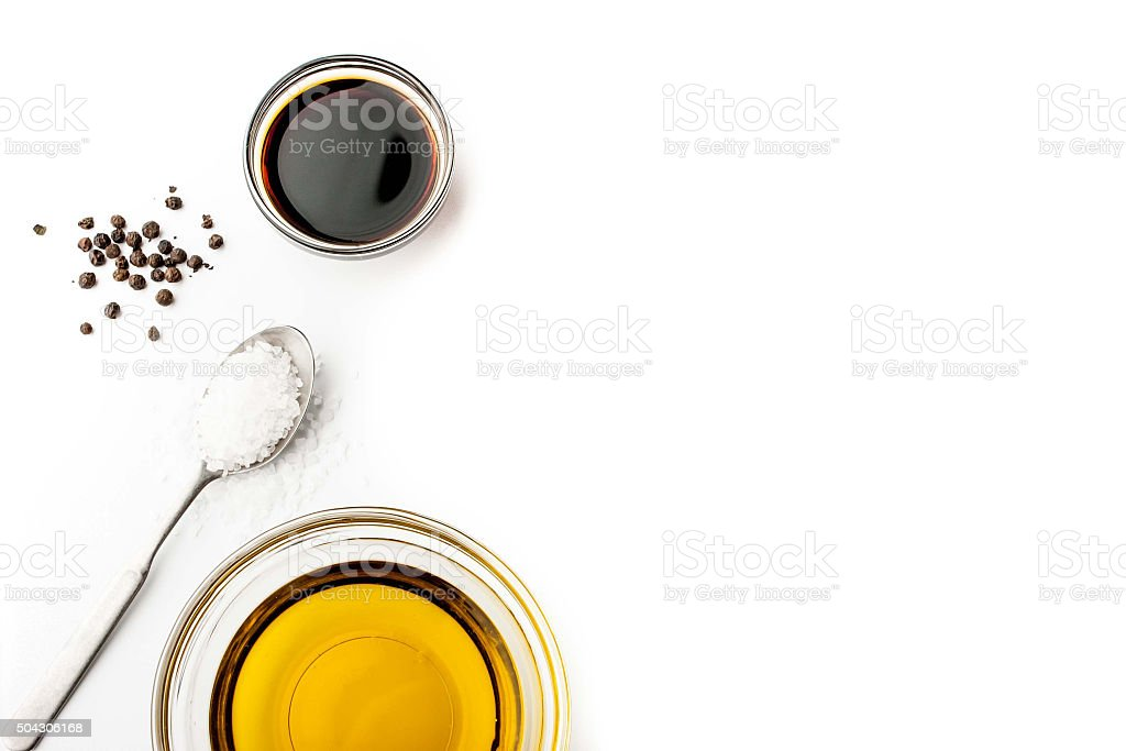 Olive oil with seasoning on the white background horizontal stock photo