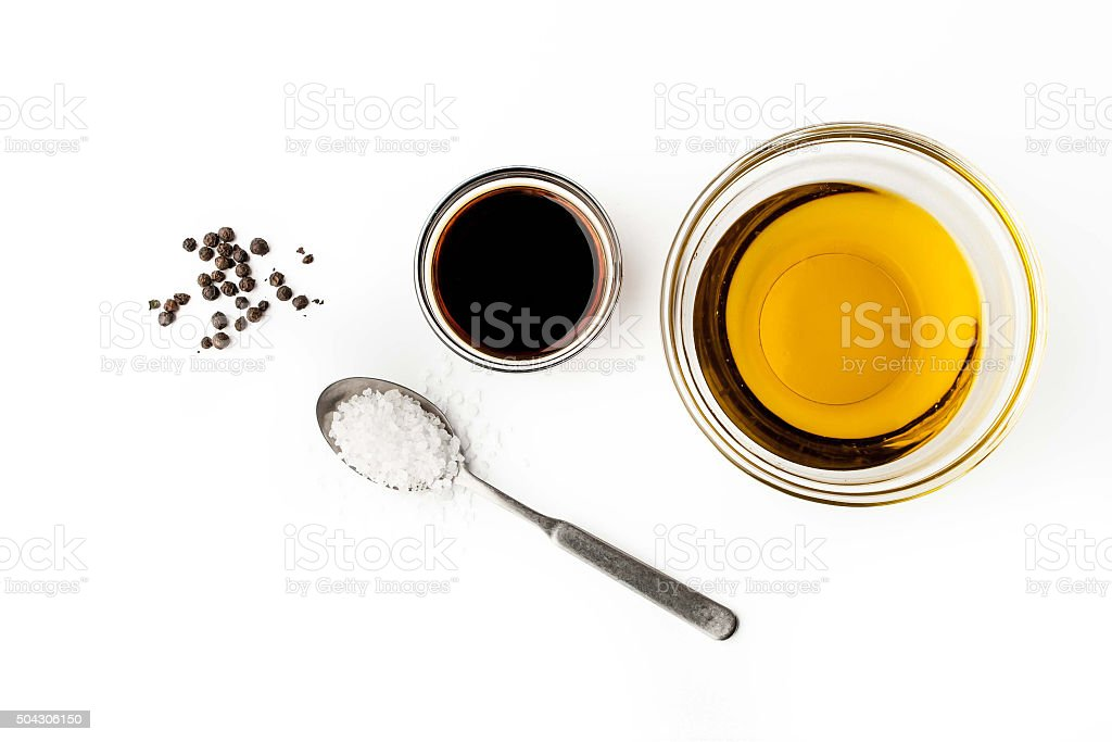 Olive oil with seasoning on the white background top view stock photo