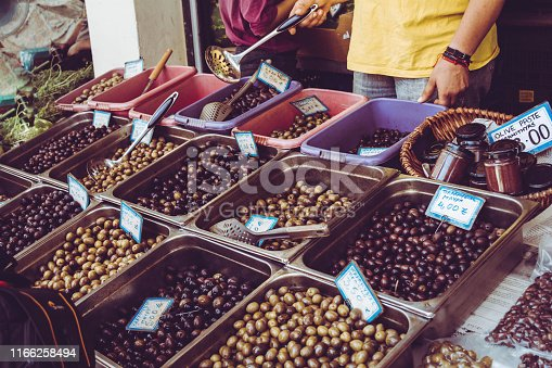 Various types of olive on a stand at the market in Corfu, Greece.