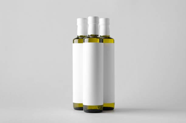 oliv / sonnenblumen / sesam öl flasche mock-up-drei flaschen. leeres etikett - erdnusssalatdressings stock-fotos und bilder