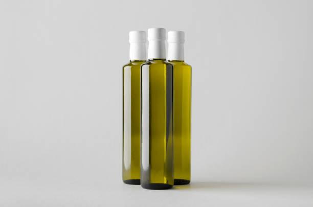 oliv / sonnenblumen / sesam öl flasche mock-up-drei flaschen - erdnusssalatdressings stock-fotos und bilder