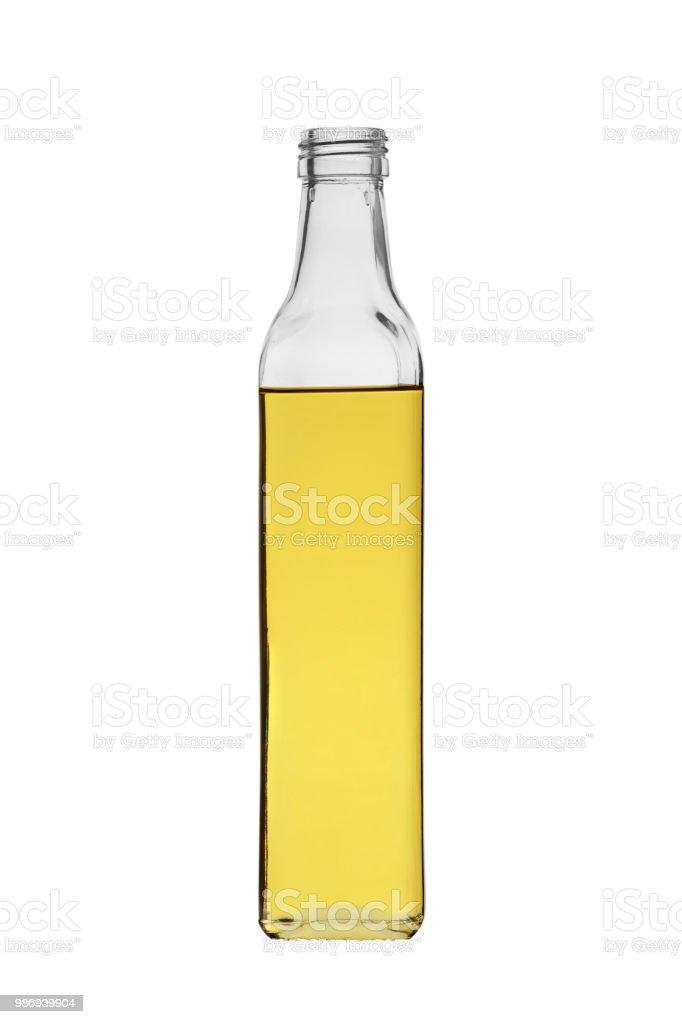 aceite vegetal en botella de vidrio sin tapa, aislada sobre fondo blanco - foto de stock