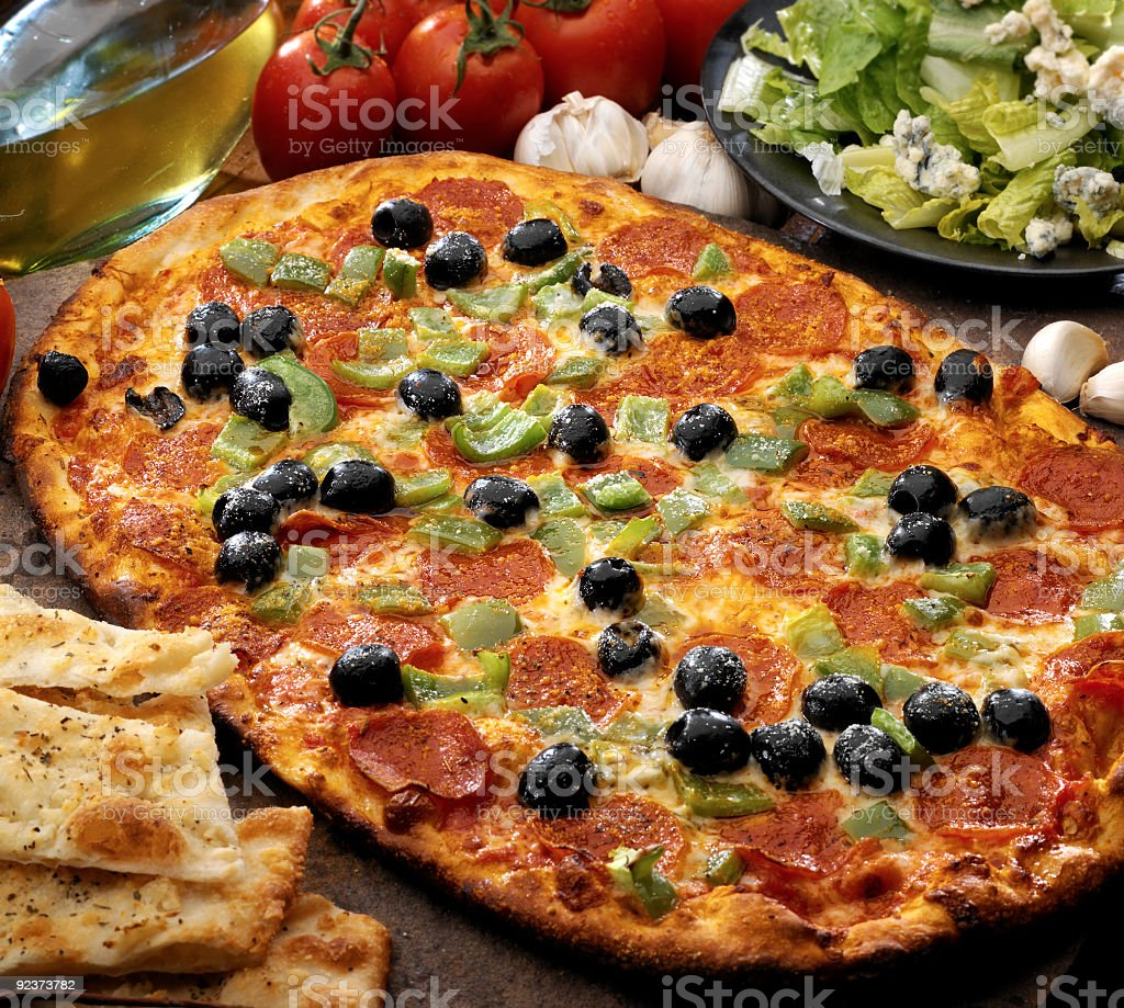 Olive,green peppers and pepperoni pizza royalty-free stock photo
