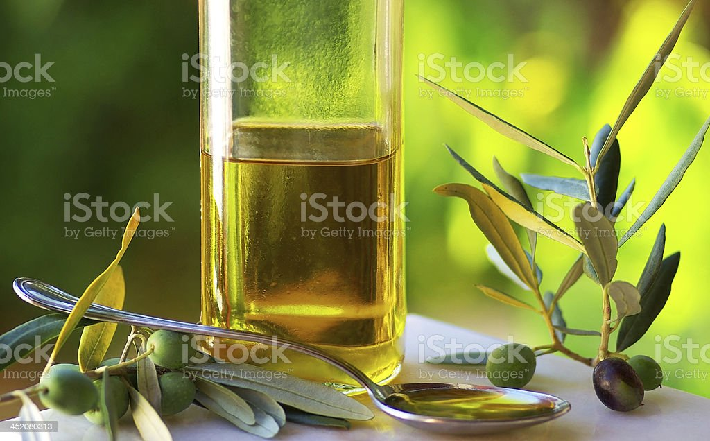 Oliveoil and olives. stock photo
